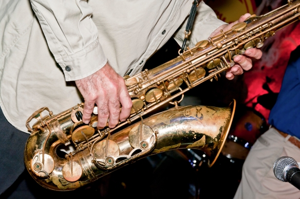 Soloing on the tenor sax is René Lavoie at a Halloween concert. Photo by Michel Loiselle