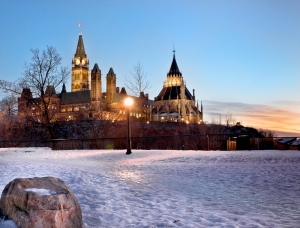 The Canadian Parliament in winter at dusk in Ottawa, Canada. Photo by Michel Loiselle